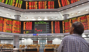 Trading screens in Kuala Lumpur, Malaysia are almost all deep in the red on Tuesday, Feb. 6, 2018.