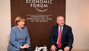 Prime Minister Benjamin Netanyahu meets with German Chancellor Angela Merkel in Davos, Switzerland, 2018.