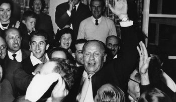 Oskar Schindler is surrounded by Holocaust survivors in Jerusalem in 1962. Upon his arrival in Israel, he was greeted by 300 Israelis he saved from the Nazis.