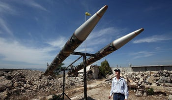 A Lebanese man looks at Hezbollah's mock rockets, at the Khiam prison which was used by Israeli troops during their occupation of southern Lebanon.