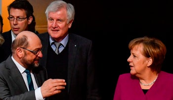 Social Democratic chief Martin Schulz, left, speaking with Christian Democratic leaders Horst Seehofer and Chancellor Angela Merkel, Berlin, February 2, 2018.