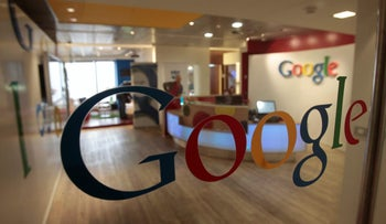 The Google logo is seen on a door at the company's office in Tel Aviv January 26, 2011