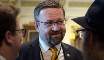 FILE - In this Tuesday, May 2, 2017, file photo, deputy assistant to President Trump, Sebastian Gorka, talks with people in the White House complex in Washington during a ceremony commemorating Israeli Independence Day. Gorka left the administration in August. Fox News confirmed to The Associated Press on Nov. 9, 2017, that Gorka had been hired by the network as a contributor. (AP Photo/Susan Walsh, File)