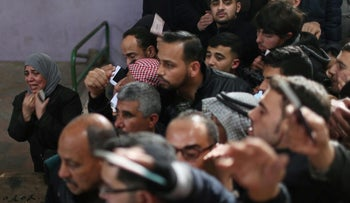 A woman is crying as she asks for a travel permit to cross into Egypt through the Rafah border crossing after it was opened by Egyptian authorities for humanitarian cases, in the southern Gaza Strip, February 8, 2018.