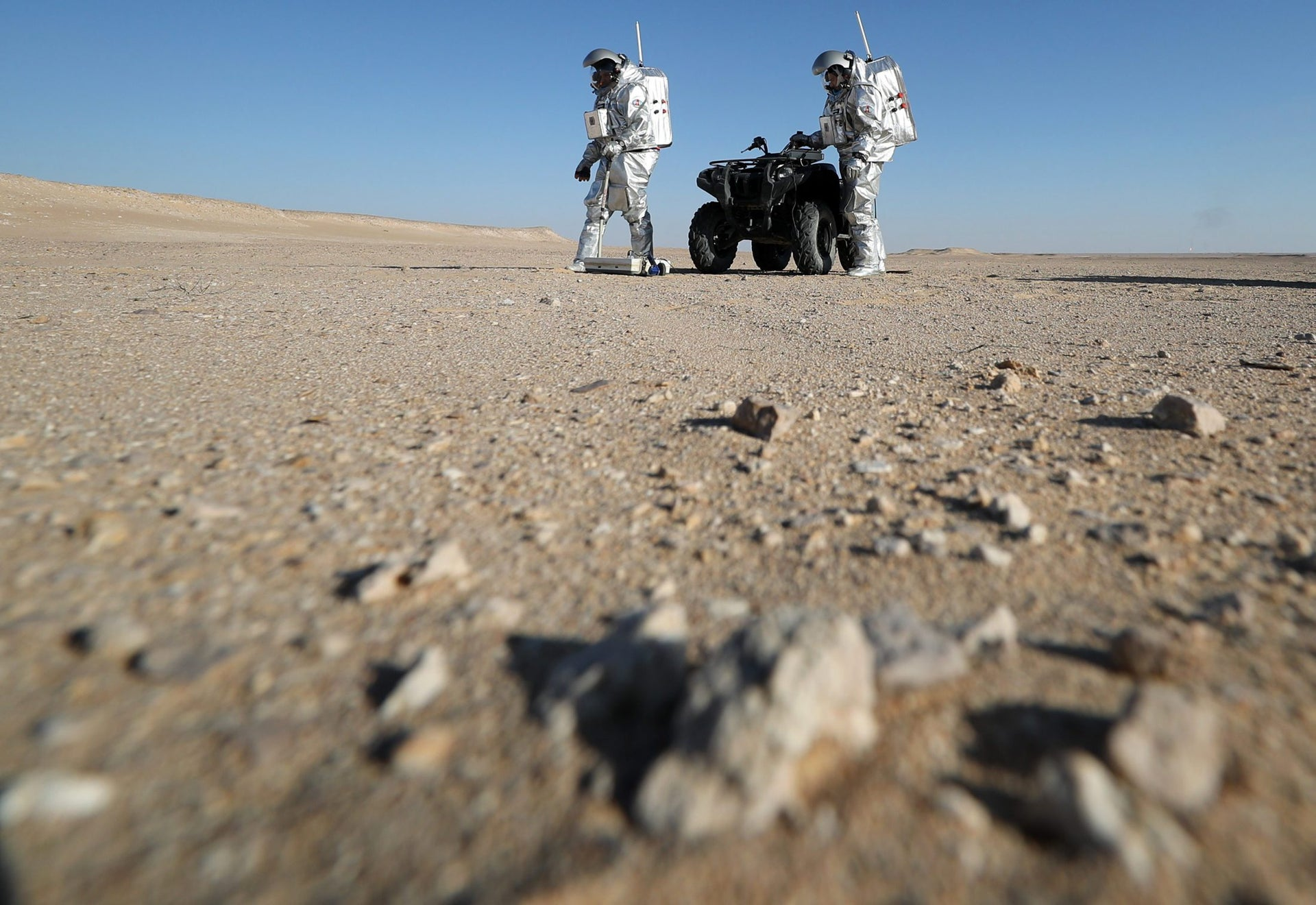 Members of the AMADEE-18 Mars simulation mission in spacesuits. Dhofar desert, Oman. February 7, 2018.