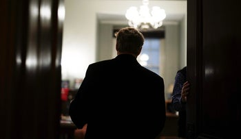 U.S. Sen. Rand Paul (R-KY) walks back to his office a TV interview at Russell Senate Office Building on Capitol Hill February 8, 2018 in Washington, DC.