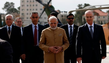 Indian Prime Minister Narendra Modi walks with Palestinian prime minister Rami Hamdallah upon his arrival in the West Bank city of Ramallah on February 10, 2018.