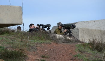 IDF troops overlooking the border at the northern Golan Heights on February 10, 2018 following the exchanges of fire with Syria.