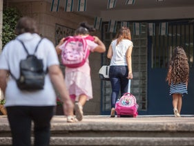 Young students entering a school in Israel (illustrative).