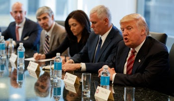 President-elect Donald Trump speaks during a meeting with technology industry leaders at Trump Tower in New York, Wednesday, Dec. 14, 2016. From left are, Amazon founder Jeff Bezos, Alphabet CEO Larry Page, Facebook COO Sheryl Sandberg, Vice President-elect Mike Pence, and Trump.