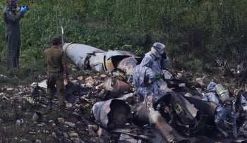 Israeli security forces examine the remains of an F-16 Israeli jet near the village of Harduf, Israel on February 10.