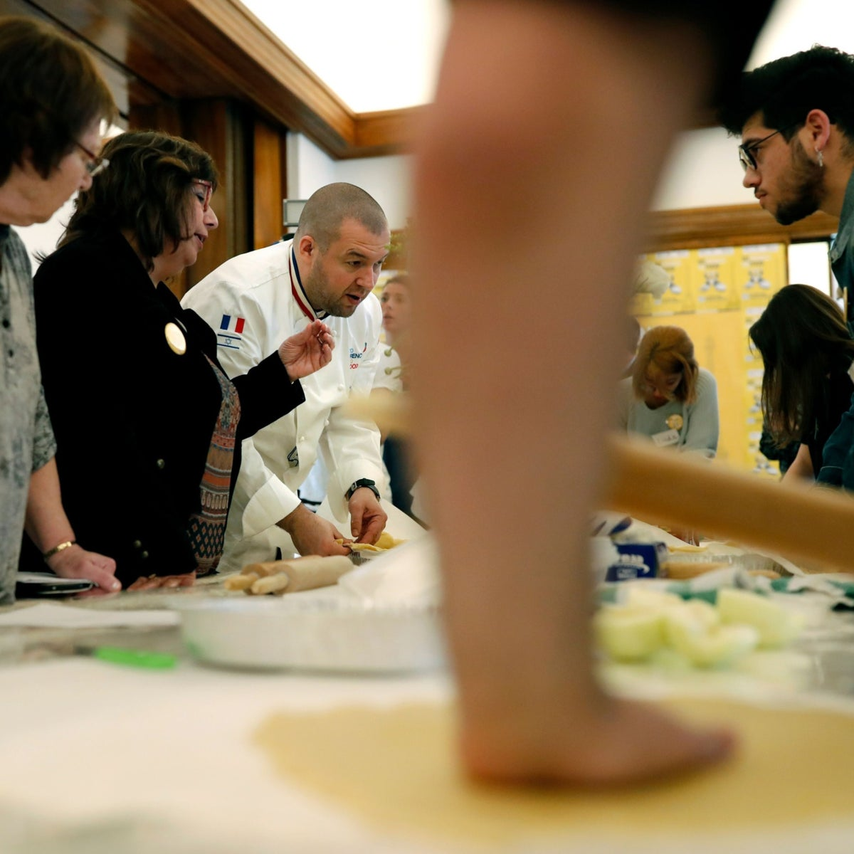 French chef Guillaume Gomez, head chef at France's Elysee palace, answers journalists question during a cooking class for teenage members of an Israeli NGO that supports LGBT rights, at the French embassador's residence in Tel Aviv on February 5, 2018,