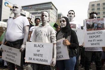 African migrants protest outside the Embassy of Rwanda in Herzliya against the Israeli government's policy to forcibly deport African refugees and asylum seekers to Rwanda and Uganda. February 7, 2018