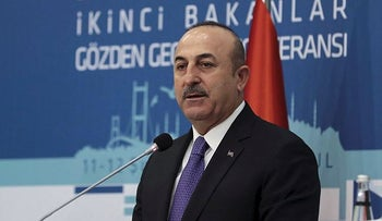 Turkish Foreign Minister Mevlut Cavusoglu speaks during a Turkey-Africa Conference in Istanbul, Monday, Feb. 12, 2018