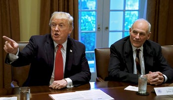 U.S. President Donald Trump gestures next to White House Chief of Staff John Kelly during a briefing with senior military leaders at the White House in Washington, DC, U.S., October 5, 2017
