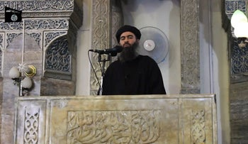 image grab taken from a propaganda video released on July 5, 2014 of Abu Bakr al-Baghdadi, aka Caliph Ibrahim, adressing Muslim worshippers at a mosque in the militant-held northern Iraqi city of Mosul.