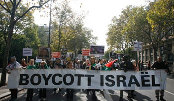 People take part in a pro-Palestinian demonstration on October 10, 2015 in Paris