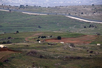 Military vehicles can be seen positioned on the Israeli side of the border with Syria, near the Druze village of Majdal Shams in the Israeli-occupied Golan Heights, Israel February 11, 2018.