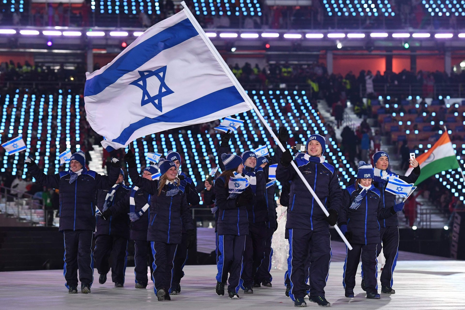 Israel's flagbearer Alexei Bychenko leads his country's delegation during the opening ceremony of the Pyeongchang 2018 Winter Olympic Games at the Pyeongchang Stadium on February 9, 2018.