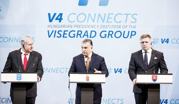Hungary's Prime Minister Viktor Orban (center) speaks as Benjamin Netanyahu (left) and Robert Fico, Slovakia's prime minister, listen during a news conference in Budapest, Hungary, July 19, 2017.