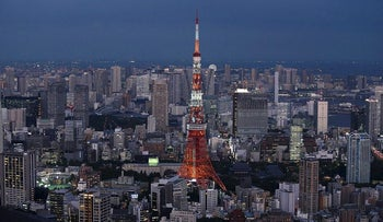 The Tokyo Tower, center, and commercial and residential buildings stand at dusk in Minato district of Tokyo, Japan, on Friday, Sept. 29, 2017