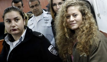 Seventeen-year-old Palestinian Ahed Tamimi (R)arrives for the beginning of her trial in the Israeli military court at Ofer military prison in the West Bank