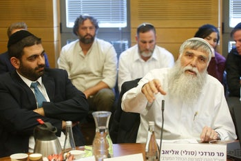 A meeting of the Knesset's Special Committee for Transparency on Tuesday February 13, pictured are MK Michael Michaeli (left) and Mordechai Eliav Western Wall Heritage Foundation managing director.