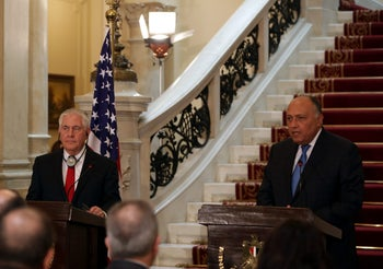 U.S. Secretary of State Rex Tillerson and Egyptian Foreign Minister Sameh Shoukry are seen during their news conference in Cairo, Egypt February 12, 2018.