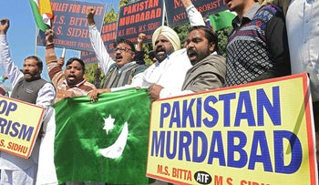 Activists of the All India Anti-Terrorist Front (AIATF) shout anti-Pakistan slogans as they hold a Pakistani flag during protests against Pakistan over the issue of sponsoring terrorism in India, in Amritsar on February 14, 2018
