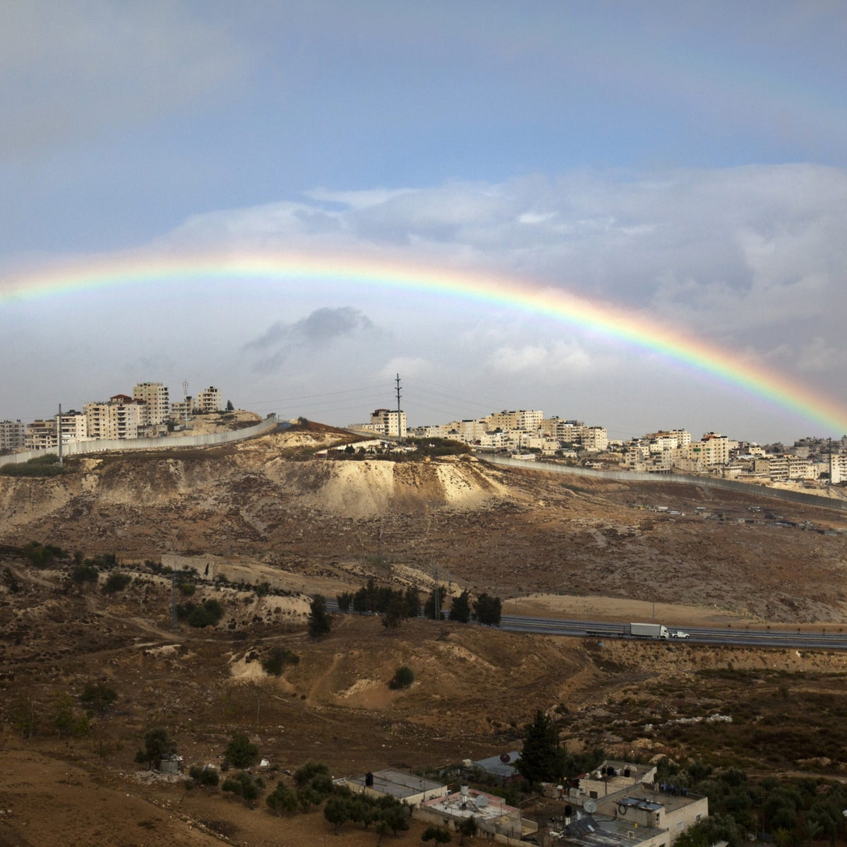 A rainbow over the Shoafat Palestinian refugee camp in Jerusalem.