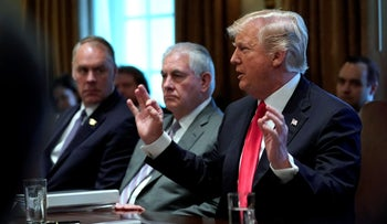 U.S. President Donald Trump, flanked by Secretary of State Rex Tillerson, holds a cabinet meeting at the White House in Washington, U.S., January 10, 2018.