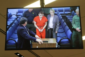 Public defenders are seen on screen at the first appearance court for high school shooting suspect Nikolas Cruz(C) on February 15, 2018 at Broward County Court House in Fort Lauderdale, Fla.