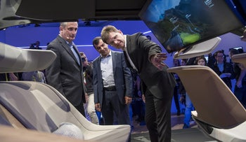 Brian Krzanich, chief executive officer of Intel Corp., from left, Amnon Shahua, chairman and chief technology officer of Mobileye