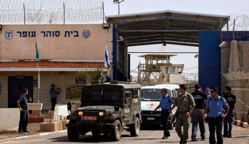 An International Committee of the Red Cross (ICRC) convoy carrying released Palestninian prisoners leaves the Ofer military prison near the West Bank city of Ramallah, Friday, Oct. 2, 2009