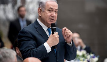 Israel's Prime Minister Benjamin Netanyahu speaks at the  International Security Conference in Munich, Germany, Friday, Feb. 16, 2018 during a lunch meeting.  (Sven Hoppe/dpa via AP)