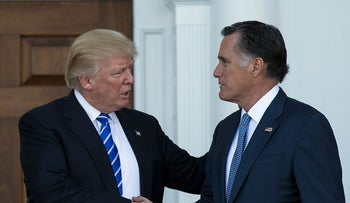 U.S. President Donald Trump shakes hands with Mitt Romney after a meeting November 19, 2016