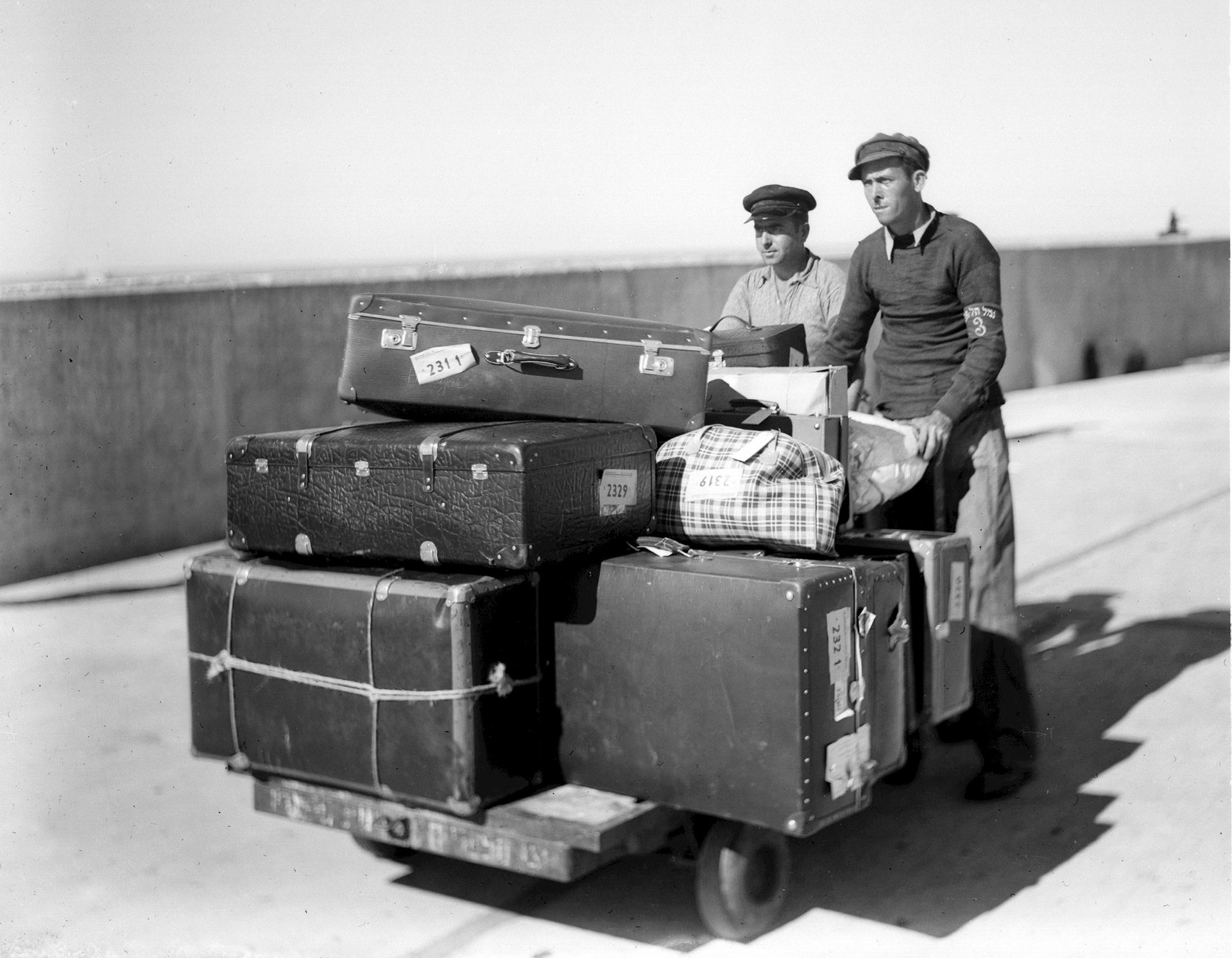 Porters taking immigrants' luggage to the terminal at Tel Aviv Port in 1938.