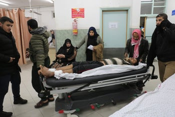 A wounded Palestinian man arrives the Rafah hospital in the southern Gaza Strip, on February 17, 2018.