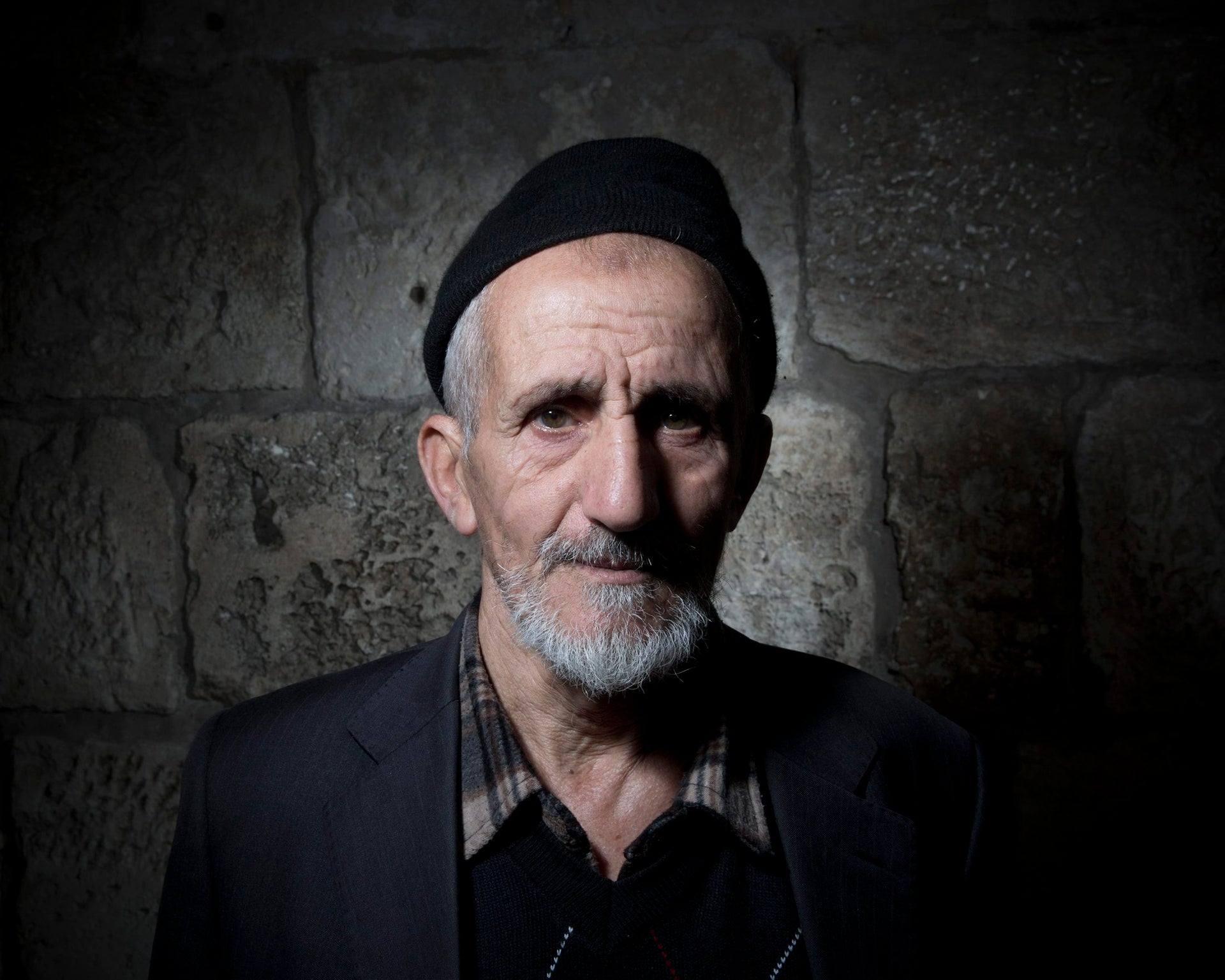 Palestinian Mohammed Asmai poses for a portrait in Jerusalem's Old City, Feb. 11, 2018.