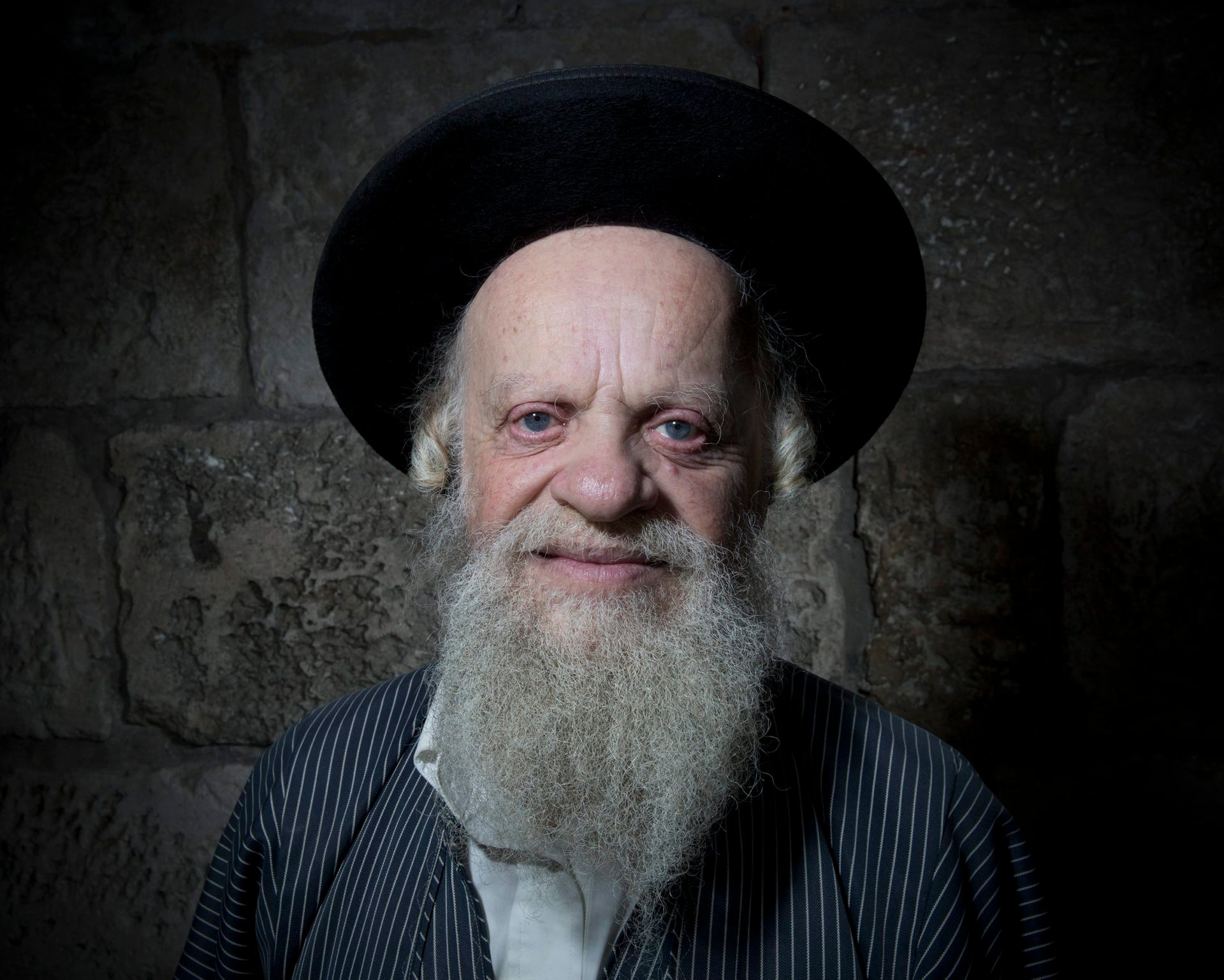 Efraim Grois, a Jewish Ultra-Orthodox poses for a portrait in Jerusalem's Old City, Feb. 11, 2018.