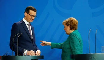 Chancellor Angela Merkel and Polish Prime Minister Mateusz Morawiecki address a news conference in Berlin, Germany, February 16, 2018.