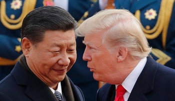 U.S. President Donald Trump chats with Chinese President Xi Jinping in Beijing, Nov. 9, 2017
