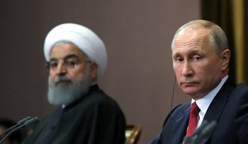 FILE PHOTO: Iran's President Hassan Rohani together with his counterpart Russia's Vladimir Putin Russia on November 22, 2017.