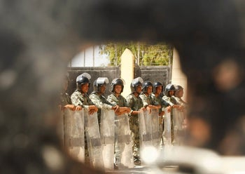 Egyptian security forces stand guard at the Rafah border crossing in the southern Gaza Strip. August 10, 2008
