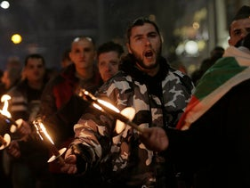 Bulgarian nationalists' supporters shout and hold torches during annual Lukov march to commemorate Bulgarian WWII pro-Nazi General Hristo Lukov in Sofia. Feb. 17, 2018