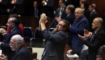 Likud MK Yehuda Glick stands to clap for U.S. President Mike Pence as he delivers a speech at the Knesset on January 21, 2018.