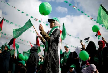 Palestinians supporting Hamas take part in a rally marking the 30th anniversary of Hamas' founding, Gaza City, December 14, 2017.