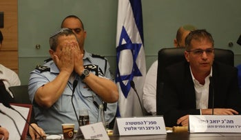 Police Commissioner Roni Alsheich, left, and MK Yoav Kish, right, in the Knesset Interior Committee on Tuesday.