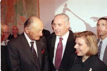 Prime Minister Benjamin Netanyahu, center, with wife Sara and Ted Arison in December 1997.