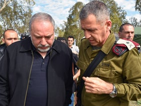 Israeli Defense Minister Avigdor Lieberman, left, with Israel Defense Forces deputy chief of staff, Maj. Gen. Aviv Kochavi, during a tour of the Israel-Gaza border, Feb. 20, 2018.